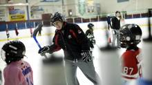 Olympic gold medalist Katie Weatherston, who has suffered multiple concussions, teaches aspiring hockey players about the game in Rockland, Ont., on March 16, 2011. (Blair Gable/Blair Gable for The Globe and Mail)