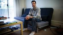 Christopher Shay, who is deaf, sits for a photograph at his apartment in Coquitlam, B.C., on June 24, 2015. Shay, who applied for social assistance in September and had five weeks pass before he received a welfare cheque, has filed a human rights complaint against the provincial Ministry of Social Development. (DARRYL DYCK For The Globe and Mail)