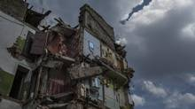 An apartment building damaged by a rocket attack on July 15, in Snizhne, Ukraine, July 23, 2014. (MAURICIO LIMA/NYT)