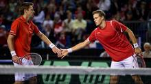 Canada's Daniel Nestor, left, of Toronto, Ont., and Vasek Pospisil, of Vernon, B.C., celebrate a point while playing Italy's Daniele Bracciali and Fabio Fognini during the first set of a Davis Cup tennis quarter-final doubles match in Vancouver, B.C., on Saturday April 6, 2013. (DARRYL DYCK/THE CANADIAN PRESS)
