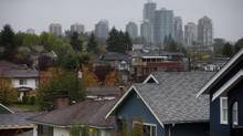 Condos in the Gilmore area of Burnaby are seen in the distance behind houses in east Vancouver, B.C., in this file photo. (Darryl Dyck for The Globe and Mail)