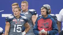 Montreal Alouettes head coach Jacques Chapdelaine, right, and player Samuel Giguere look on from the sideline during first half CFL football action between the Alouettes and the Toronto Argonauts in Montreal, Sunday, October 2, 2016. (Graham Hughes/THE CANADIAN PRESS)