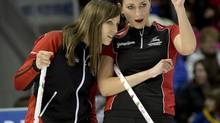 Ontario skip Rachel Homan, left, and Emma Miskew watch a shot during the page playoff curling action against Manitoba at the Scotties Tournament of Hearts Saturday, February 23, 2013 in Kingston, Ont.. (Ryan Remiorz/THE CANADIAN PRESS)