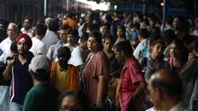 Stranded passengers wait for power to be restored at a New Delhi railway station on July 30, 2012. (Rajesh Kumar Singh/AP)
