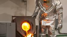 A worker wearing heatproof suit pours molten gold from a crucible into a mould in a workshop of Altyntau gold mine extraction factory outside northern Kazakhstan's town of Kokshetau June 13, 2013. (Shamil Zhumatov/Reuters)