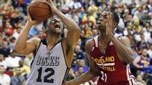 Jabari Parker (12) of the Milwaukee Bucks drives by Andrew Wiggins of the Cleveland Cavaliers in an NBA summer league basketball Friday, July 11, 2014, in Las Vegas. (John Locher/AP)