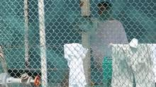 Omar Khadr is seen in Guantanamo Bay's Camp 4 on Saturday, Oct. 23, 2010, days before the 24-year-old Canadian was convicted of five war crimes and sentenced to eight more years. (Colin Perkel/THE CANADIAN PRESS)