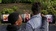 People attend a memorial outside an apartment building in Seattle on June 18, 2017. (Ken Lambert/AP)
