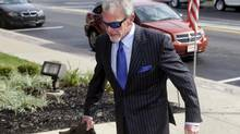 Indianapolis Colts owner Jim Irsay enters Hamilton County court in Noblesville, Ind., Tuesday, Sept. 2, 2014. (Michael Conroy/AP)