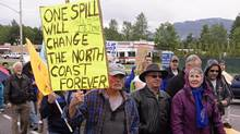 Protestors march through the streets of Kitimat, B.C., June 24, 2012. About 250 people rallied against the Northern Gateway Pipeline project, which would carry oil sands bitumen from Alberta to Kitimat for shipment to Asia. (Robin Rowland/THE CANADIAN PRESS)