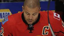 Jarome Iginla #12 of the Calgary Flames knocks the pucks down at the start of warm up before his game against the St Louis Blues on October 28, 2011 at the Scotiabank Saddledome in Calgary, Alberta, Canada. (Photo by Dale MacMillan/Getty Images) (Dale MacMillan/2011 Getty Images)