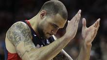 Gonzaga's Robert Sacre reacts in the second half against Saint Mary's during the NCAA West Coast Conference tournament championship basketball game, Monday, March 5, 2012, in Las Vegas. Saint Mary's won in overtime 78-74. (AP Photo/Julie Jacobson) (Julie Jacobson/AP)