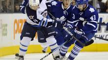Winnipeg Jets forward Kyle Wellwood (L) battles for the puck against Toronto Maple Leafs forward Nazem Kadri (R) during the first period of their NHL game in Toronto January 5, 2012. (MIKE CASSESE/REUTERS)