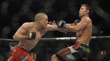Georges St-Pierre, red shorts, fought to a unanimous decision win over Jake Shields in the welterweight title bout at UFC 129 at the Rogers Centre on April 30 2011. (Fred Lum/Fred Lum/The Globe and Mail)