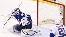 The New York Islanders fifth goal off the stick of Islanders Frans Nielsen gets past Leafs James Reimer(34) during the third period of the Toronto Maple Leafs versus the New York Islanders NHL game at the ACC in Toronto on April 18, 2013. (Peter Power/The Globe and Mail)