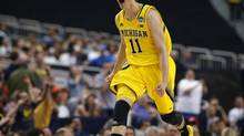 Michigan Wolverines guard Nik Stauskas celebrates scoring over the Florida Gators in their South Regional NCAA men's basketball game in Arlington, Texas March 31, 2013. (JIM YOUNG/REUTERS)