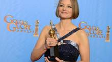 Jodie Foster poses with the Cecile B. DeMille award for outstanding contribution to the entertainment field backstage at the 70th Annual Golden Globe Awards at the Beverly Hilton Hotel on Sunday Jan. 13, 2013, in Beverly Hills, Calif. (Jordan Strauss/AP)