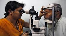 A villager undergoes an eye examination at an Aravind-organized clinic in rural India. (REINHARD KRAUSE/Reuters)