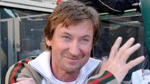NHL Hall of Famer Wayne Gretzky stands in the dugout of the Minnesota Twins prior to their game against the Los Angeles Angels of Anaheim on Opening Day at Angel Stadium on April 5, 2010 in Anaheim, California. (Kevork Djansezian/Getty Images)