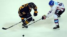 Brad Boyes of Buffalo is challenged by Steve Wagner of Mannheim during the NHL presason game between Buffalo Sabres and Adler Mannheim at SAP Arena on Tuesday. (Lars Baron/2011 Getty Images)