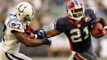 Buffalo Bills running back C.J. Spiller (21) rushes past Indianapolis Colts' Jacob Lacey (27) in the first quarter of a preseason NFL football game in Toronto on Thursday, Aug. 19, 2010. (AP Photo/Mike Groll) (Michael Groll)