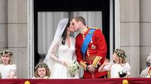 Britain's Prince William and his wife Kate, Duchess of Cambridge kiss on the balcony in Buckingham Palace, after the wedding service, on April 29, 2011, in London. (LEON NEAL/LEON NEAL/AFP/Getty Images)