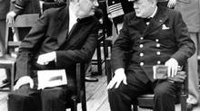 U.S. President Franklin D. Roosevelt, left, and British Prime Minister Winston Churchill confer after church services aboard the battleship Prince of Wales during the Atlantic Conference at Argentia Bay off Newfoundland in this Aug. 10, 1941 file photo. (Associated Press)