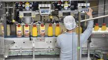 A picture taken on June 5, 2015 shows a worker checking bottles of margarine on the packaging line at the Unilever's factory in Rotterdam. (JOHN THYS/AFP/Getty Images)