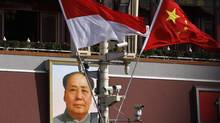Indonesian and Chinese national flags are seen hanging from a pole in front of the portrait of former Chinese chairman Mao Zedong at the Tiananmen Square in Beijing, March 23, 2012. REUTERS/David Gray (CHINA - Tags: POLITICS) (DAVID GRAY/REUTERS)