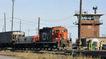 A CN locomotive makes its way through the CN Taschereau yard in Montreal. (Graham Hughes/THE CANADIAN PRESS)