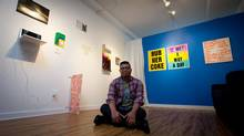 "Wil Aballe operates an art gallery out of his apartment reatsits for a photograph at his apartment where he operates an art gallery in Vancouver, B.C., on Wednesday July 23, 2014. His latest show ""A Spectacle and Nothing Strange"" examines work by several artists who use or have used text to explore gay themes. (DARRYL DYCK/THE GLOBE AND MAIL)"