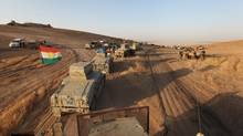 Military vehicles of the Kurdish Peshmerga forces are seen on the southeast of Mosul, Iraq, on Aug. 14, 2016. (Azad Lashkari/Reuters)