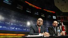 London Stock Exchange CEO Xavier Rolet, left, and TMX Group CEO Tom Kloet. (Mark Blinch/Reuters)