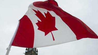 A Canadian flag flies on Parliament Hill in Ottawa.