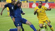 Sweden's Emir Bajrami (R) vies with Moldova's Petru Racu during their UEFA Euro 2012 qualifying group E football match in Chisinau on June 3, 2011. (VADIM DENISOV/AFP/Getty Images)