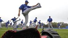 Toronto Blue Jays catcher J.P. Arencibia stretches during practice at their MLB American League spring training facility in Dunedin. (MIKE CASSESE/Reuters)