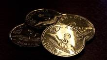 The Royal Canadian Mint unveils the 2012 lucky Loonie coin in 2012. (Jeff McIntosh/The Canadian Press)
