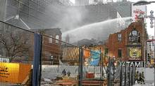 Firefighters work to extinguish the last remaining of fire at the the old Salad King, an heritage building located on Yonge and Gould Streets that resulted destroyed by a six-alarm blaze. (Fernando Morales/The Globe and Mail/Fernando Morales/The Globe and Mail)