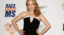 "FILE - In this May 2, 2014 file photo, actress Lea Thompson arrives at the 21st Annual Race to Erase MS Gala in Los Angeles. Thompson is one of 13 contestants on the new season of ""Dancing With the Stars,"" premiering Sept. 15, on ABC (Dan Steinberg/Dan Steinberg/Invision/AP)"