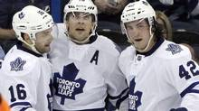 Toronto Maple Leafs right wing Joffrey Lupul, centre, celebrates with left wing Clarke MacArthur, left, and center Tyler Bozak, right, after scoring against the Tampa Bay Lightning during the second period of an NHL hockey game Wednesday, April 24, 2013, in Tampa, Fla (Associated Press)