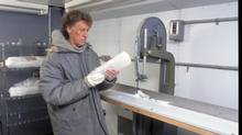 Ice cores, like the one held in this picture, provide a record of how current concentrations of carbon dioxide and rising global temperatures due to fossil fuel emission differ drastically from natural climate variations since the depths of the last ice age. (Anthony Scullion/Natural Resources Canada)