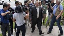 The media follows Doug Ford as he leaves the Etobicoke Civic Centre, in Toronto, for lunch on Tuesday. (Matthew Sherwood for the globe and mail)