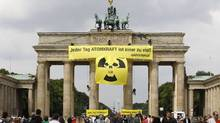 Greenpeace activists roll out a nuclear power protest banner atop the Brandenburg Gate in Berlin. The banner read: Every day with nuclear power is one day too much. (Tobias Schwarz/Reuters)