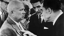 Take that! Richard Nixon, then U.S. vice-president, gives Nikita Khrushchev a poke during their infamous 'kitchen debate.' The Soviet premier scored a few points of his own. (© Corbis. All Rights Reserved.)