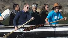 The Duke and Duchess of Cambridge paddle with a group in a traditional Haida canoe in the waters of Haida Gwaii on Sept. 30, 2016. (JONATHAN HAYWARD/THE CANADIAN PRESS)