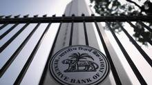 The Reserve Bank of India (RBI) seal is pictured on a gate outside the RBI headquarters in Mumbai October 29, 2013. India's central bank raised its policy interest rate for the second time in as many months on Tuesday, warning that inflation is likely to remain elevated for the rest of the fiscal year, and rolled back an emergency measure put in place in July to support the slumping rupee. REUTERS/Danish Siddiqui (INDIA - Tags: BUSINESS POLITICS LOGO) (DANISH SIDDIQUI/REUTERS)