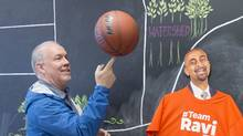 British Columbia NDP Leader John Horgan plays with a basketball while visiting NDP candidate Ravi Kahlon's campaign headquarters in North Delta, B.C, Monday, April, 10, 2017. THE CANADIAN PRESS/Jonathan Hayward (JONATHAN HAYWARD/THE CANADIAN PRESS)