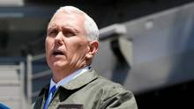 U.S. Vice President Mike Pence delivers a speech to U.S. and Japanese service members on the flight deck of the USS Ronald Reagan, a Nimitz-class nuclear-powered super carrier, at the U.S. naval base in Yokosuka, south of Tokyo, on April 19, 2017. (KIM KYUNG-HOON/REUTERS)