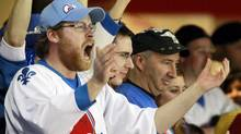 A fan of the former Canadian hockey team Quebec Nordiques cheers during the third period of an NHL hockey game between the Boston Bruins and the New Jersey Devils, Sunday, April 10, 2011, in Newark, N.J. The Devils won 3-2. (AP Photo/Julio Cortez) (Julio Cortez)