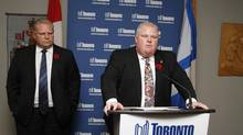 Toronto Mayor Rob Ford speaks at a press conference on Nov. 5, 2013, as his brother, Councillor Doug Ford, looks on. (FERNANDO MORALES/THE GLOBE AND MAIL)
